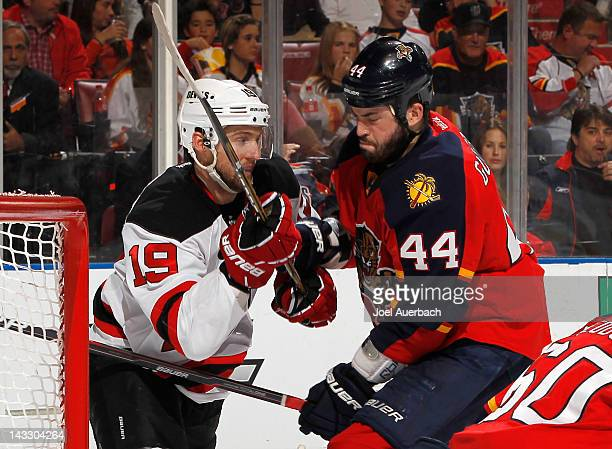 Erik Gudbranson of the Florida Panthers prevents Travis Zajac of the New Jersey Devils from going after the rebound in Game Five of the Eastern...
