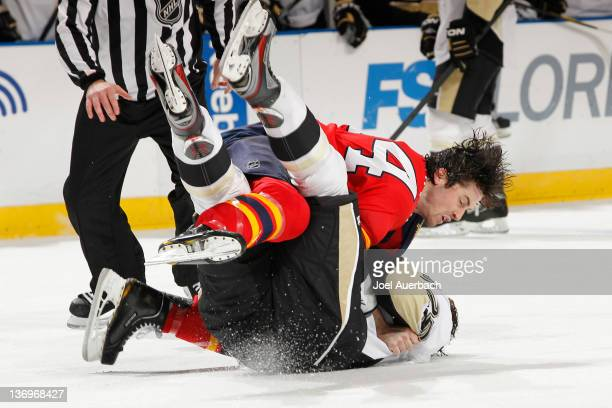 Erik Gudbranson of the Florida Panthers takes Eric Tangradi of the Pittsburgh Penguins to the ice during a fight on January 13 2012 at the...