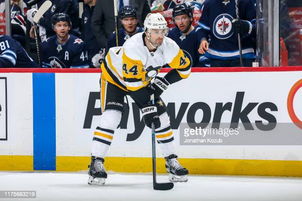 Erik Gudbranson of the Pittsburgh Penguins gets set during a first period faceoff against the Winnipeg Jets at the Bell MTS Place on October 13 2019...