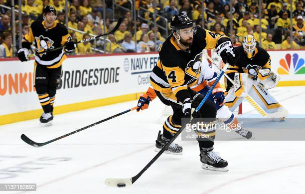 Erik Gudbranson of the Pittsburgh Penguins moves the puck up ice against the New York Islanders during the third period in Game Three of the Eastern...
