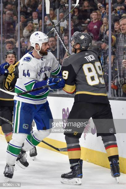 Erik Gudbranson of the Vancouver Canucks and Alex Tuch of the Vegas Golden Knights shove each other after the whistle during the game at TMobile...