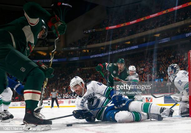 Erik Gudbranson of the Vancouver Canucks blocks the shot of Jordan Greenway of the Minnesota Wild during a game at Xcel Energy Center on November 15,...