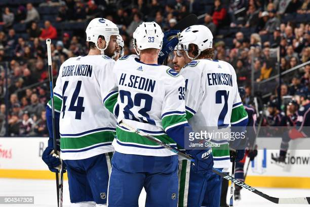 Erik Gudbranson of the Vancouver Canucks celebrates his second period goal with his fellow teammates during a game against the Columbus Blue Jackets...