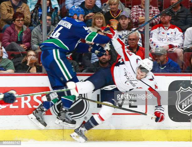 Erik Gudbranson of the Vancouver Canucks checks Tom Wilson of the Washington Capitals during their NHL game at Rogers Arena October 26 2017 in...