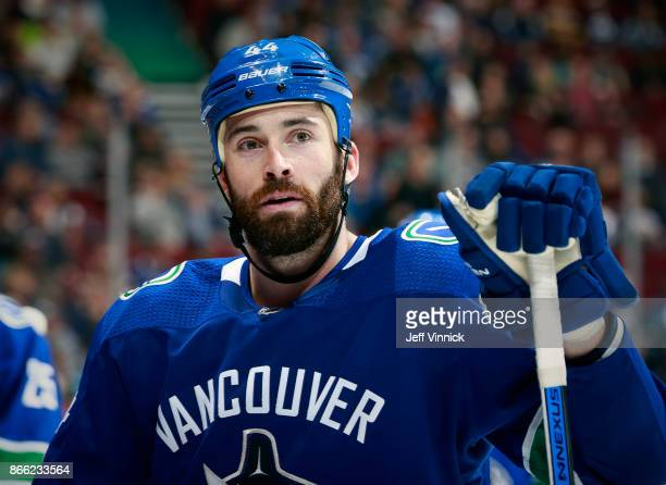 Erik Gudbranson of the Vancouver Canucks looks on from the bench during their NHL game against the Winnipeg Jets at Rogers Arena October 12 2017 in...