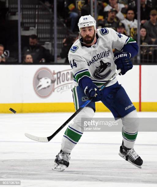 Erik Gudbranson of the Vancouver Canucks passes the puck against the Vegas Golden Knights in the third period of their game at TMobile Arena on...