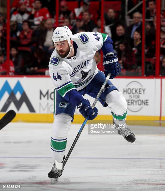 Erik Gudbranson of the Vancouver Canucks passes the puck during an NHL game against the Carolina Hurricanes on February 9 2018 at PNC Arena in...