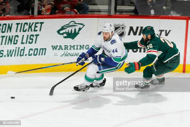 Erik Gudbranson of the Vancouver Canucks skates in front of Daniel Winnik of the Minnesota Wild during the game at the Xcel Energy Center on January...