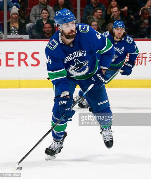 Erik Gudbranson of the Vancouver Canucks skates up ice with the puck during their NHL game against the San Jose Sharks at Rogers Arena February 11...