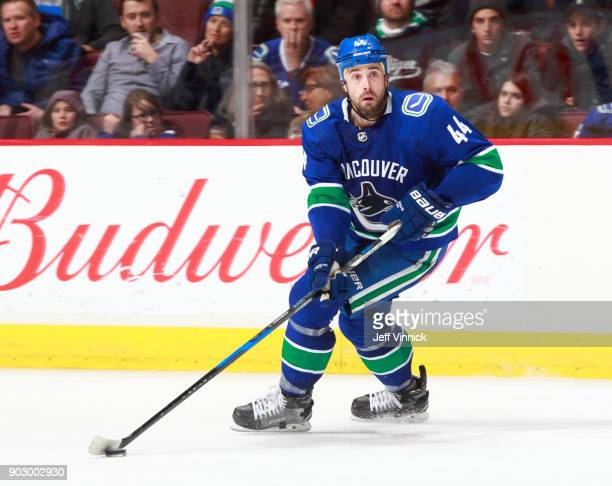 Erik Gudbranson of the Vancouver Canucks skates up ice with the puck during their NHL game against the Anaheim Ducks at Rogers Arena January 2 2018...