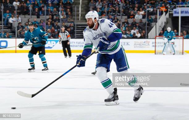 Erik Gudbranson of the Vancouver Canucks skates with the puck against the San Jose Sharks at SAP Center on February 15 2018 in San Jose California