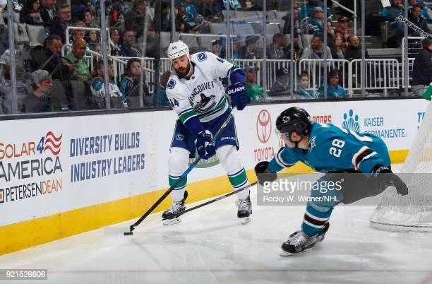 Erik Gudbranson of the Vancouver Canucks skates with the puck against Timo Meier of the San Jose Sharks at SAP Center on February 15 2018 in San Jose...
