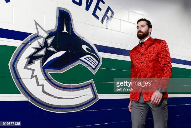 Erik Gudbranson of the Vancouver Canucks sports a Chinese styled jacket as he walks to the Canucks dressing room before their NHL game at Rogers...