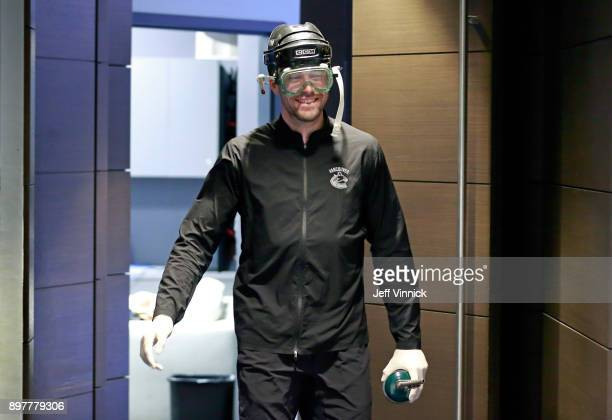 Erik Gudbranson of the Vancouver Canucks sports safety gear as he walks to prepare his game sticks before their NHL game against the St Louis Blues...