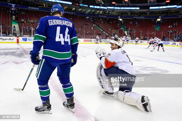Erik Gudbranson of the Vancouver Canucks talks with Roberto Luongo of the Florida Panthers before their NHL game at Rogers Arena February 14 2018 in...