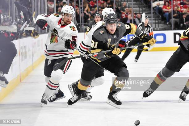 Erik Gustafsson and Nick Schmaltz of the Chicago Blackhawks skate to the puck against Jonathan Marchessault of the Vegas Golden Knights during the...