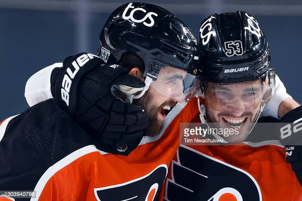 Erik Gustafsson and Shayne Gostisbehere of the Philadelphia Flyers celebrate a goal during the first period against the New York Rangers at Wells...