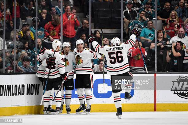Erik Gustafsson Gustav Forsling and Brandon Saad of the Chicago Blackhawks celebrate scoring a goal against the San Jose Sharks at SAP Center on...