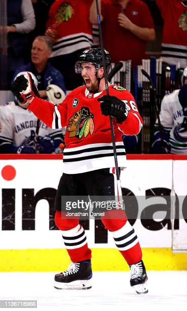 Erik Gustafsson of the Chicago Blackhawks celebrates his gametying goal in the third period against the Vancouver Canucks at the United Center on...