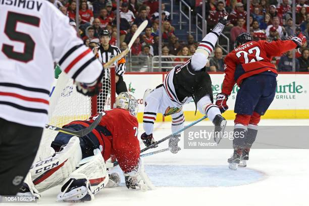 Erik Gustafsson of the Chicago Blackhawks scores a goal in front of Madison Bowey of the Washington Capitals during the third period at Capital One...