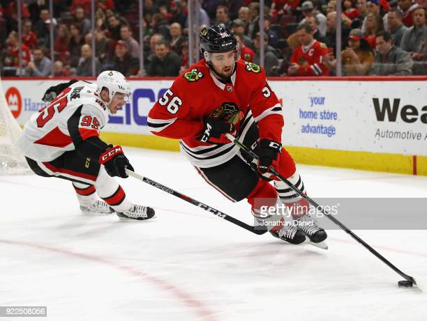 Erik Gustafsson of the Chicago Blackhawks turns with the puck under pressure from Matt Duchene of the Ottawa Senators at the United Center on...