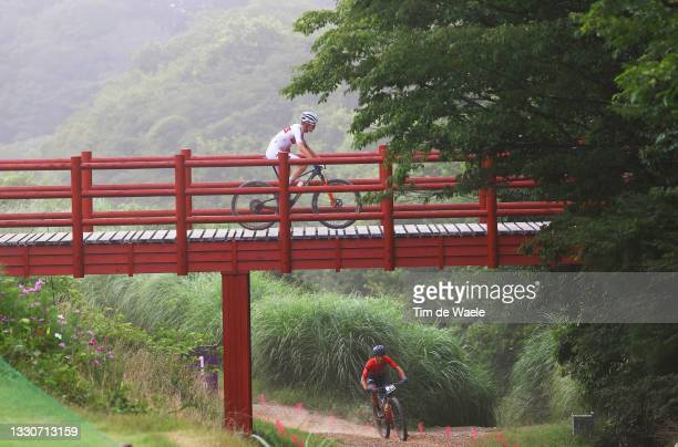 Erik Haegstad of Team Norway and Andras Parti of Team Hungary crosses a bridge on the circuit during the Men's Cross-country race on day three of the...