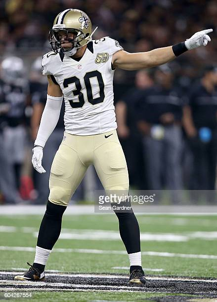 Erik Harris of the New Orleans Saints stands on the field during a game against the Oakland Raiders at the MercedesBenz Superdome on September 11...