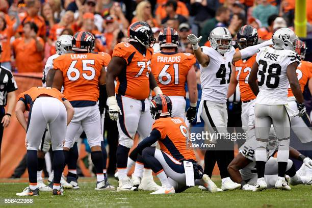 Erik Harris of the Oakland Raiders celebrates a missed field goal by Brandon McManus of the Denver Broncos during the fourth quarter on Sunday...