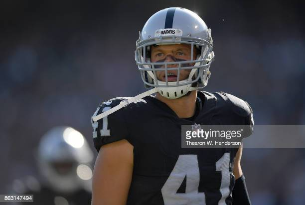 Erik Harris of the Oakland Raiders reacts after making a play on punt coverage against the Los Angeles Chargers during an NFL football game at...