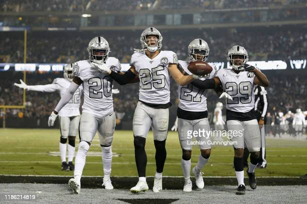 Erik Harris of the Oakland Raiders reacts with teammates after intercepting a pass by Philip Rivers of the Los Angeles Chargers in the second quarter...