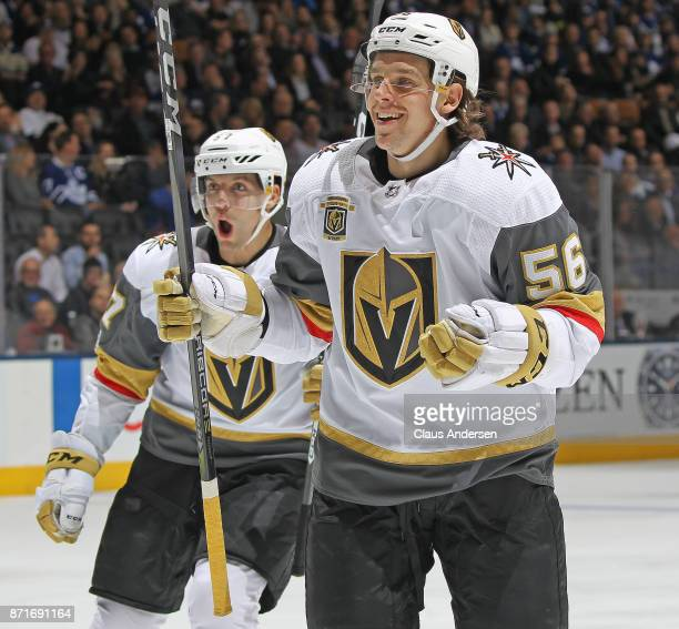 Erik Haula and David Perron of the Vegas Golden Knights celebrate a goal by teammate James Neal against the Toronto Maple Leafs during an NHL game at...