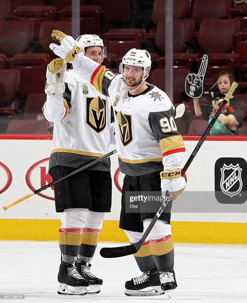 Erik Haula #56 and Tomas Tatar #90 of the Vegas Golden Knights celebrate the 3-2 win over the Philadelphia Flyers on March 12, 2018 at Wells Fargo Center in Philadelphia, Pennsylvania.