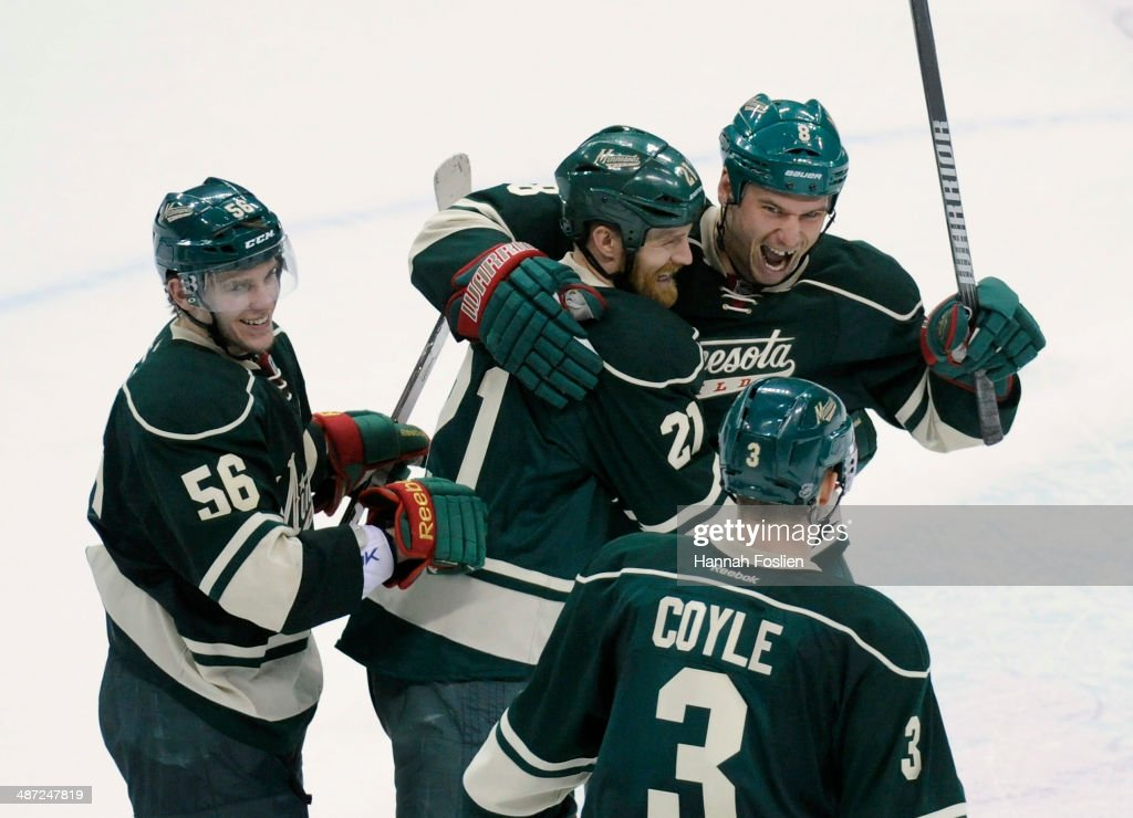 Erik Haula #56, Kyle Brodziak #21, Cody McCormick #8 and Charlie Coyle #3 of the Minnesota Wild celebrate a win against the Colorado Avalanche after Game Six of the First Round of the 2014 NHL Stanley Cup Playoffs on April 28, 2014 at Xcel Energy Center in St Paul, Minnesota. The Wild defeated the Avalanche 5-2.