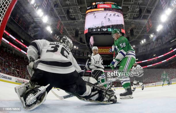 Erik Haula of the Carolina Hurricanes looks to deflect a puck past the Jack Campbell of the Los Angeles Kings during an NHL game on January 11 2020...