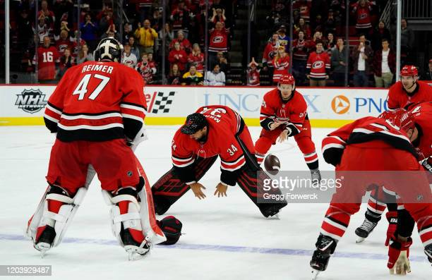 Erik Haula of the Carolina Hurricanes participates in a Storm Surge as he takes a snap from teammate Petr Mrazek following an NHL game against the...
