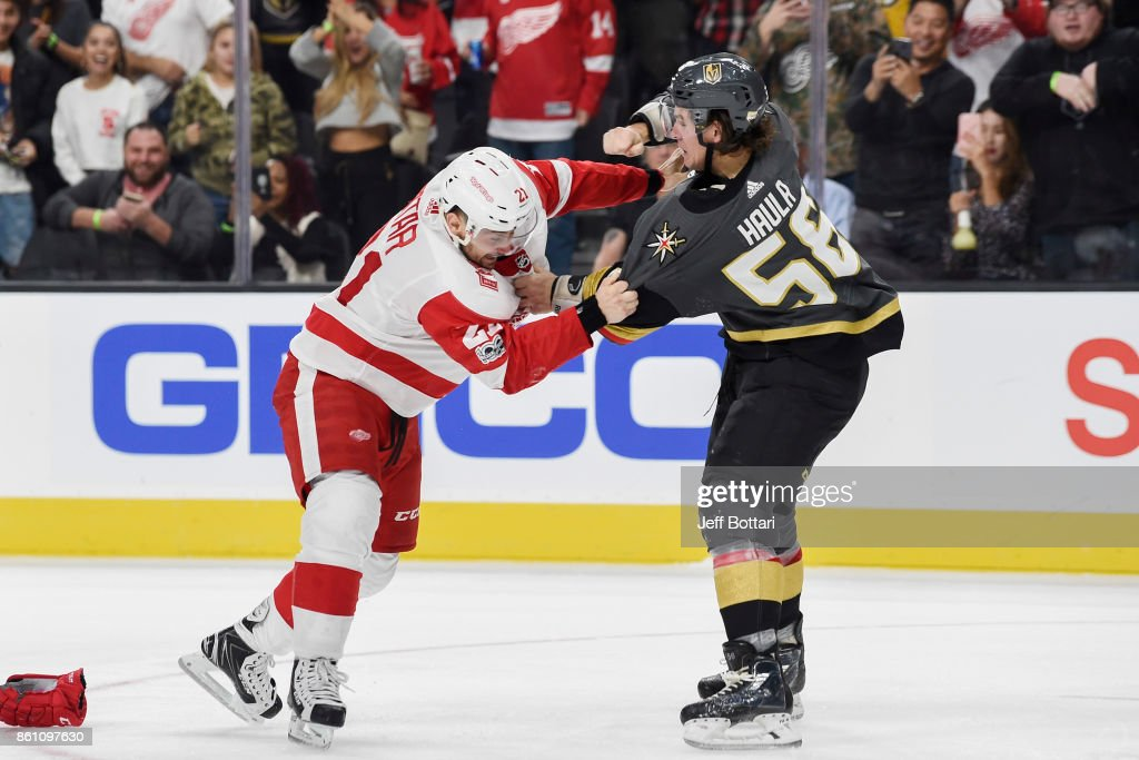 Erik Haula #56 of the Vegas Golden Knights and Mike Green #25 of the Detroit Red Wings fight during the game at T-Mobile Arena on October 13, 2017 in Las Vegas, Nevada.