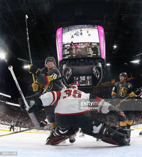 Erik Haula of the Vegas Golden Knights crashes into Louis Domingue of the Arizona Coyotes during the Golden Knights' inaugural regularseason home...