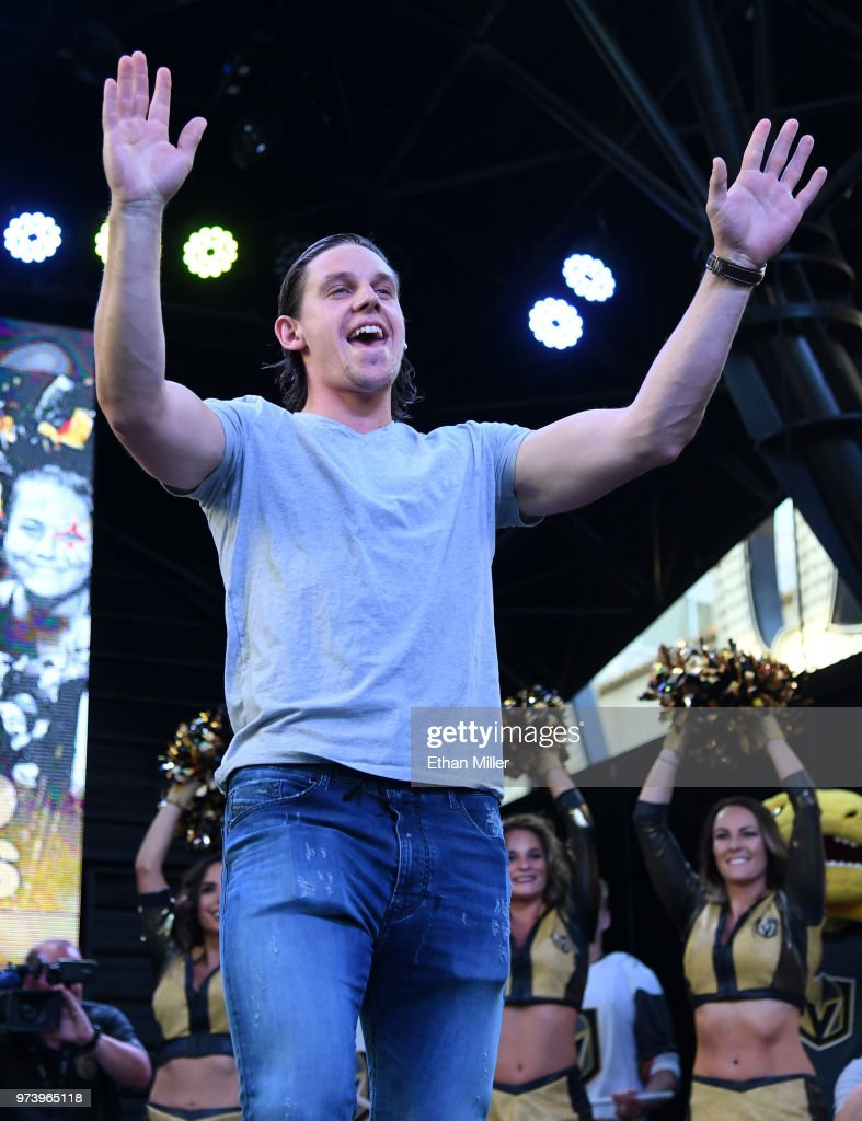 Erik Haula #56 of the Vegas Golden Knights gestures to fans as he is introduced at the team's 'Stick Salute to Vegas and Our Fans' event at the Fremont Street Experience on June 13, 2018 in Las Vegas. Nevada. The Golden Knights made it to the Stanley Cup Final in the team's inaugural season, losing to the Washington Capitals four games to one in the series.