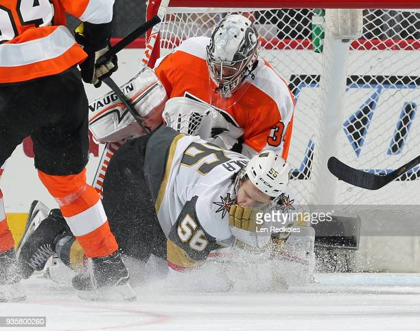 Erik Haula of the Vegas Golden Knights reacts to a slash to the face in front of goaltender Petr Mrazek of the Philadelphia Flyers on March 12 2018...
