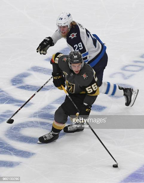 Erik Haula of the Vegas Golden Knights skates with the puck against Patrik Laine of the Winnipeg Jets in the third period of Game Four of the Western...