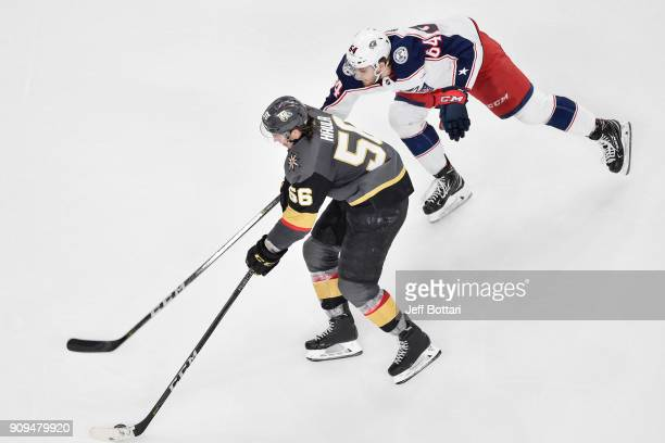 Erik Haula of the Vegas Golden Knights skates with the puck while Tyler Motte of the Columbus Blue Jackets defends during the game at TMobile Arena...