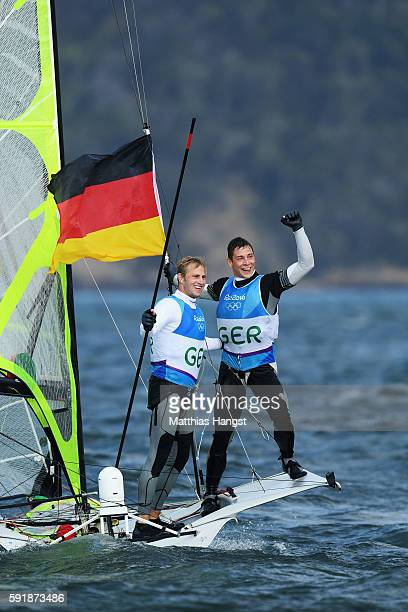 Erik Heil of Germany and Thomas Ploessel of Germany celebrate after winning the bronze medal in the Men's 49er class at the Marina da Gloria on Day...