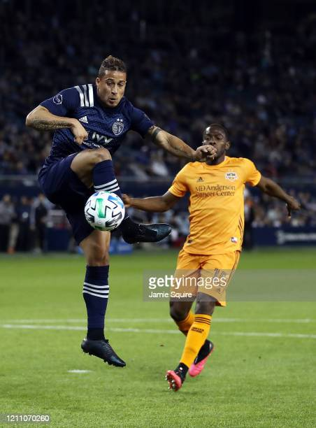 Erik Hurtado of Sporting Kansas City controls the ball as Maynor Figueroa of Houston Dynamo defends during the game at Children's Mercy Park on March...