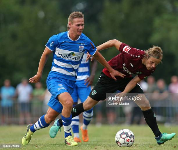 Erik Israelsson of PEC Zwolle and Iver Fossum of Hannover battle for the ball during the preseason friendly match between Hannover 96 and PEC Zwolle...