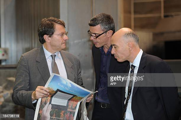 """Erik Izraelewicz , director of French daily newspaper """"Le Monde"""" speaks with the chief of the publication in the Haute-Garonne department, Lionel..."""