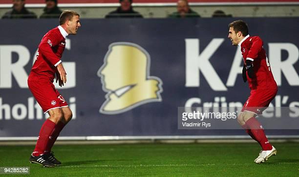 Erik Jendrisek celebrates with his team mate Adam Nemec of Kaiserslautern after scoring his team's second goal during the Second Bundesliga match...