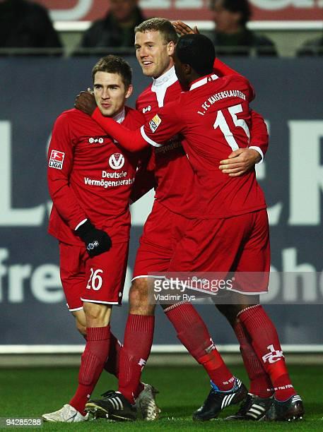 Erik Jendrisek celebrates with his team mates Adam Nemec and Georges Mandjeck of Kaiserslautern after scoring his team's second goal during the...