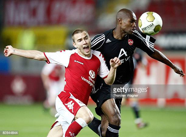 Erik Jendrisek of Kaiserslautern battles for the ball with Jose Goncalves of Nuernberg during the Second Bundesliga match between 1FC Kaiserslautern...