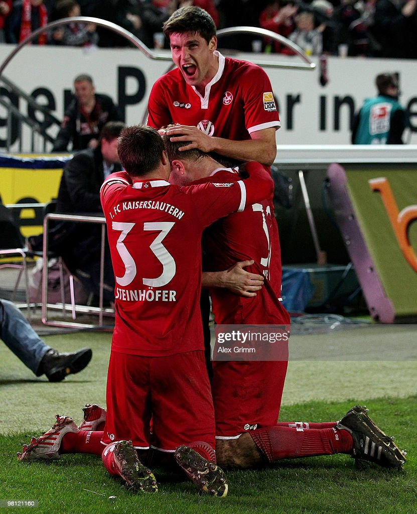 Erik Jendrisek (C, hidden) of Kaiserslautern celebrates his team's third goal with team mates Markus Steinhoefer (L), Adam Nemec (R) and Florian Dick (back) during the Second Bundesliga match between 1. FC Kaiserslautern and 1860 Muenchen at the Fritz-Walter Stadium on March 29, 2010 in Kaiserslautern, Germany.