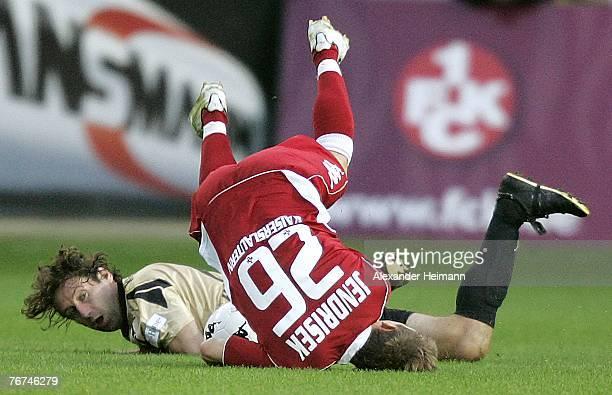 Erik Jendrisek of Kaiserslautern competes with Thomas Klaesener of Paderborn during the Bundesliga 2nd match between 1FC Kaiserslautern and SC...